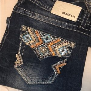 Grace in LA Bootcut jeans w blue Aztec accents
